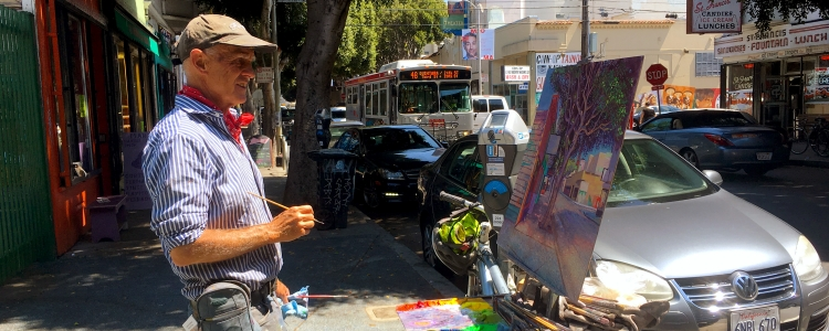 photo of artist painting a street scene